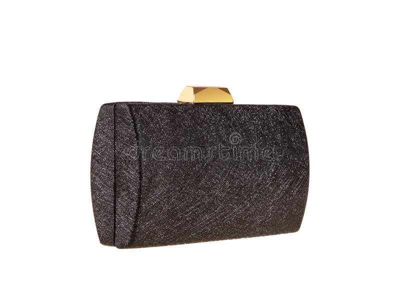 Little black fashion purse handbag with a golden clasp stock photography