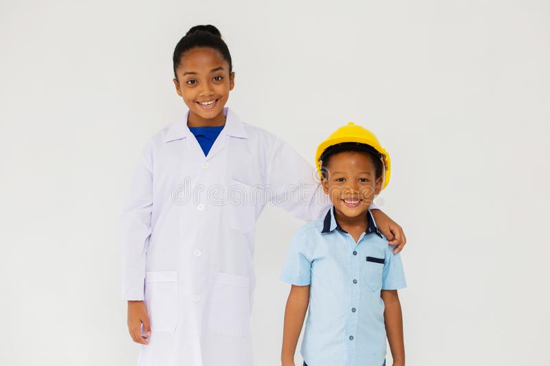 Little black scientist and engineer smiling for camera stock image