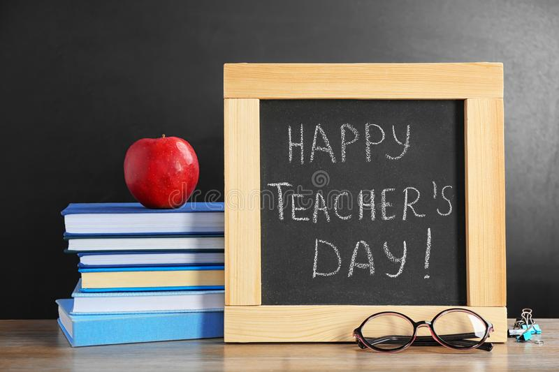 Little blackboard with inscription HAPPY TEACHER`S DAY royalty free stock images