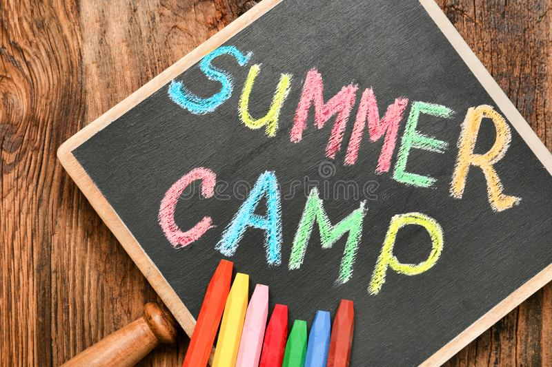 Little blackboard with text SUMMER CAMP chalked stock photography