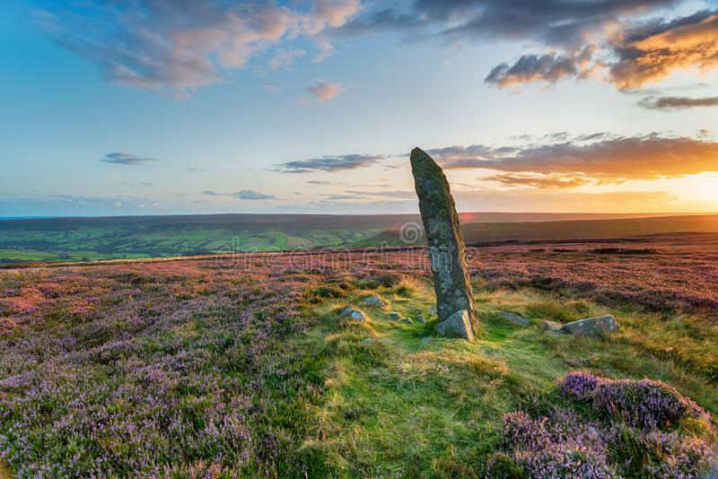 Little Blakey Howe on the North York Moors. Sunset at Little Blakey Howe, a bronze age round barrow topped with an ancient standing stone on Blakey Ridge in the stock image