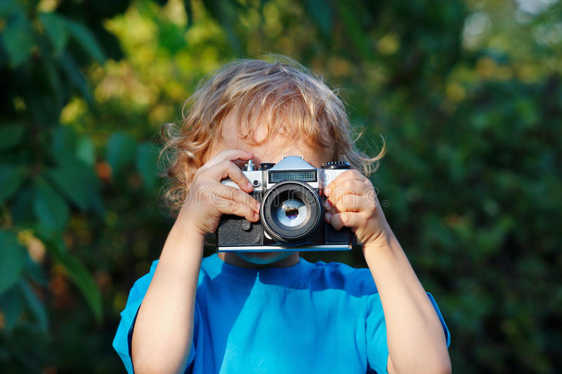 Download Little Blond Boy With A Camera Shoots You Stock Image - Image: 26005539