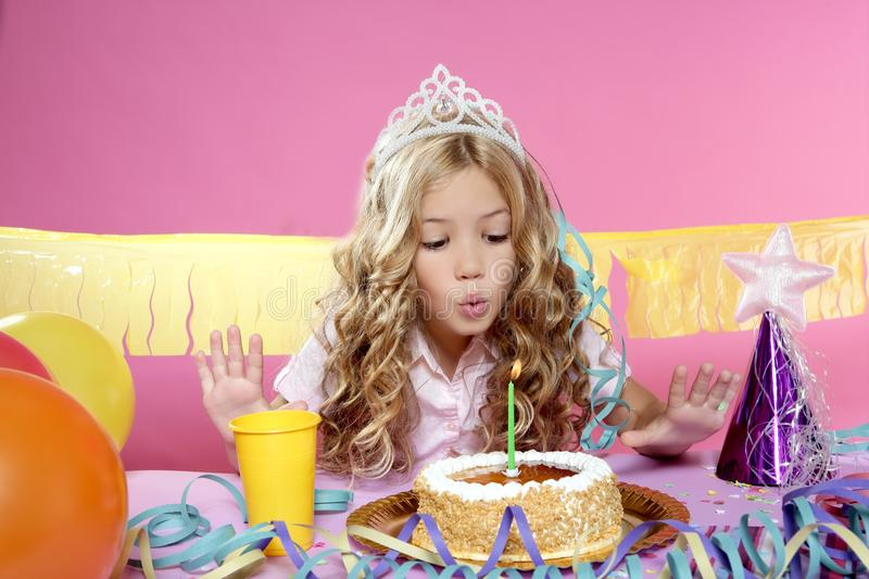 Little blond girl in a birthday party royalty free stock images