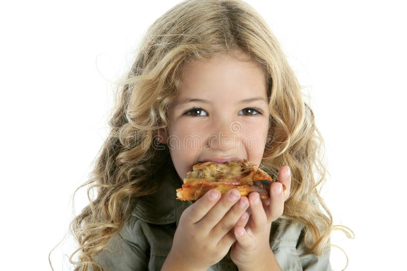 Little blond girl eating pizza stock photography