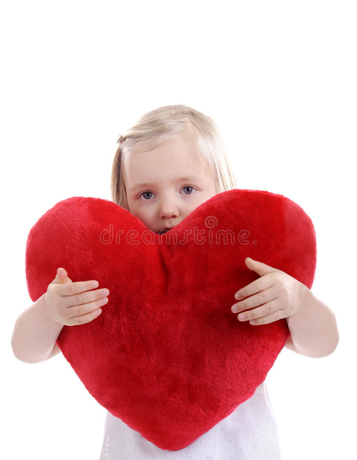 Download Little Blond Girl With Heart Shaped Pillow Stock Image - Image: 18737697