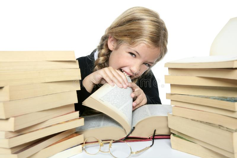 Download Little Blond Student Girl Eating Her Books Stock Photo - Image of little, background: 16379184