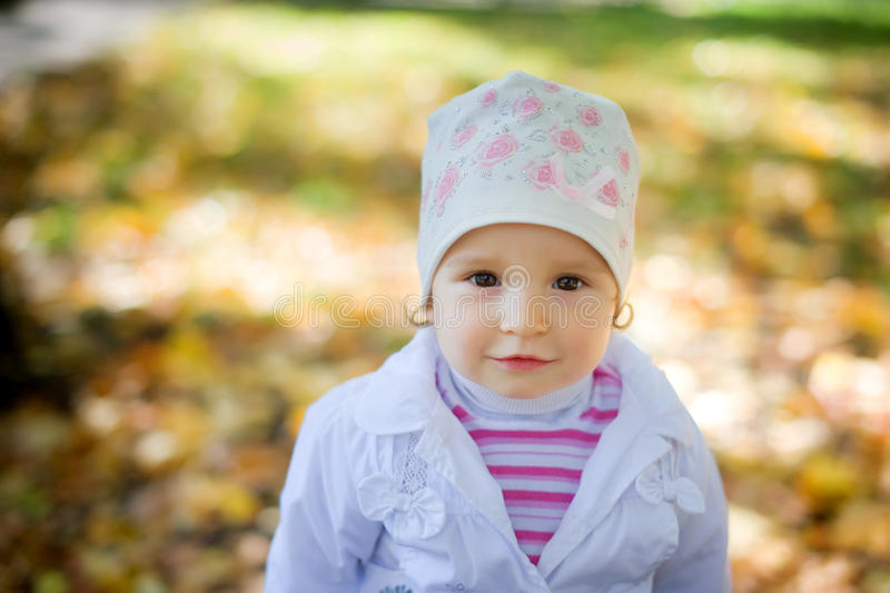 Little blonde blue-eyed with a cheeky expression stock photography