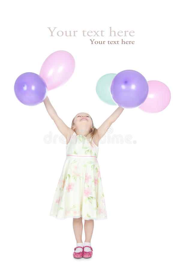 Little blonde girl with balloons posing in studio