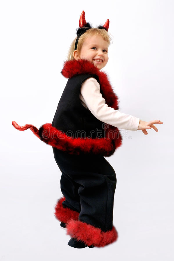 Little blonde girl, dressed in an devil on carnival royalty free stock photos