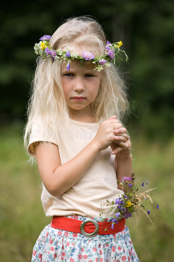 Little blonde girl in flower wreath royalty free stock photos