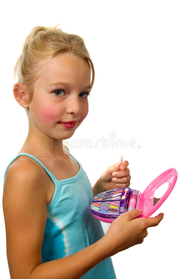 Little blonde girl is playing with make-up stock images