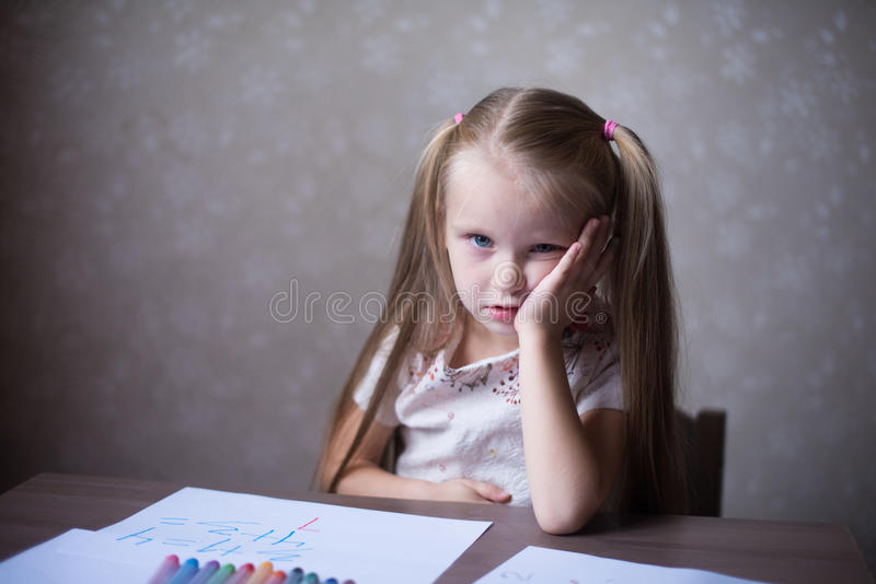 The little blonde girl thought stock photos