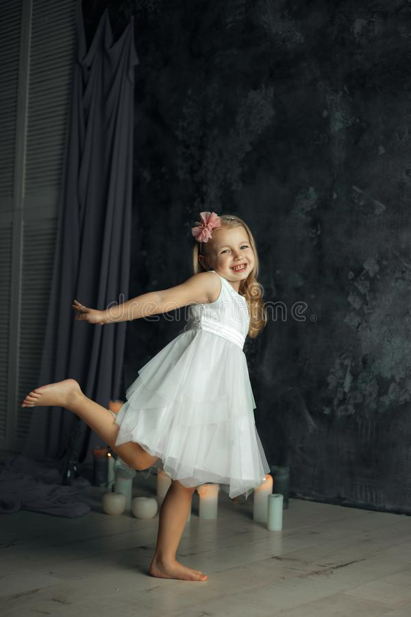 Little blonde hair girl as ballerina stock photo