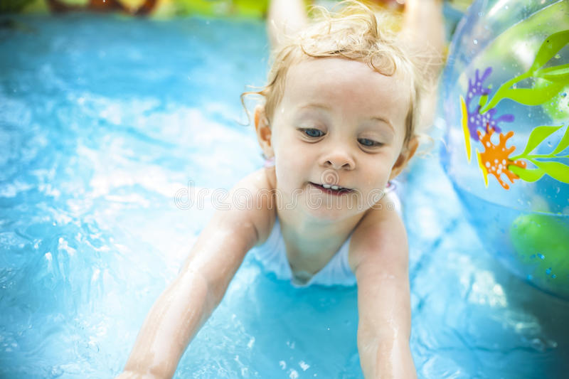 Download Little Blondie Girl In Swimming Pool Stock Photo - Image: 25873558
