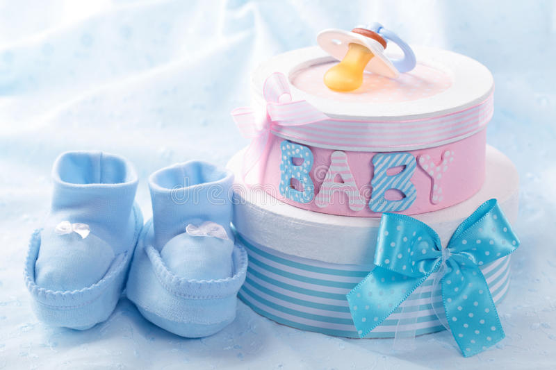 Little blue baby booties stock image