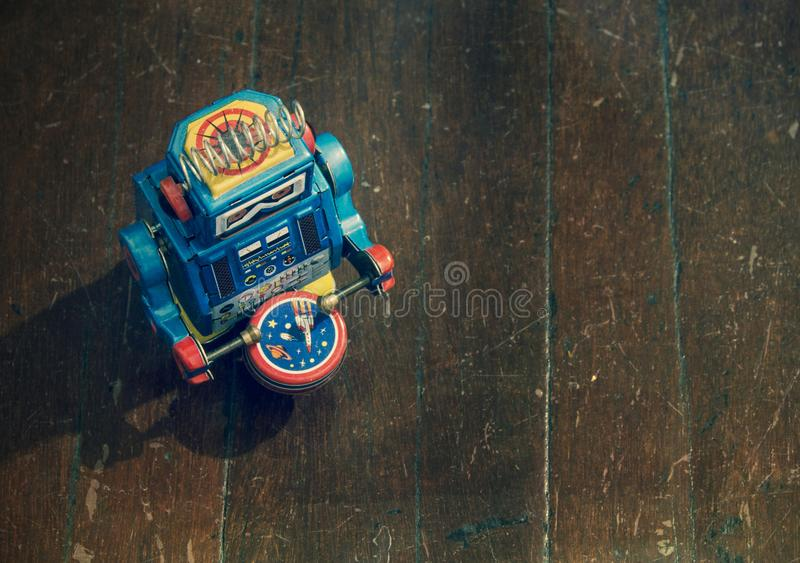Little blue robot drummer on old wooden royalty free stock image