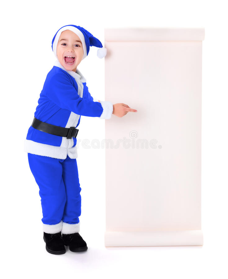 Download Little Blue Santa Claus Boy Pointing At Big Wish List Royalty Free Stock Photography - Image: 34688057