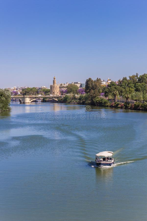 Little boat on the river Guadalquivir in Sevilla. Spain royalty free stock images