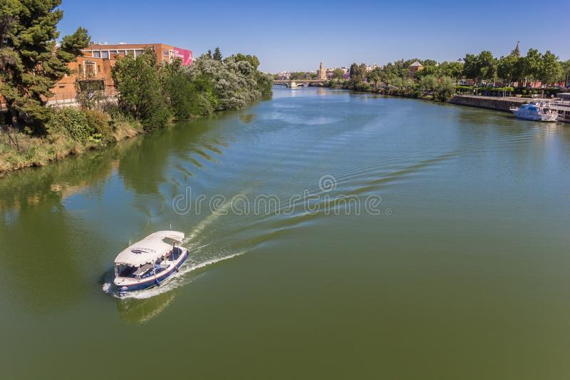 Little boat on the river Guadalquivir in Sevilla. Spain stock images