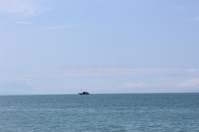 Little boat in the sea stock images