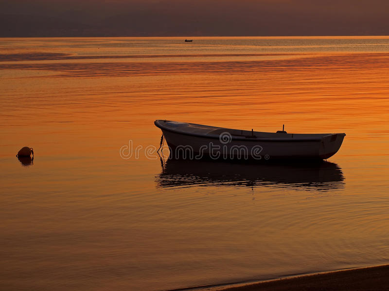 Little boat at sunset royalty free stock photo