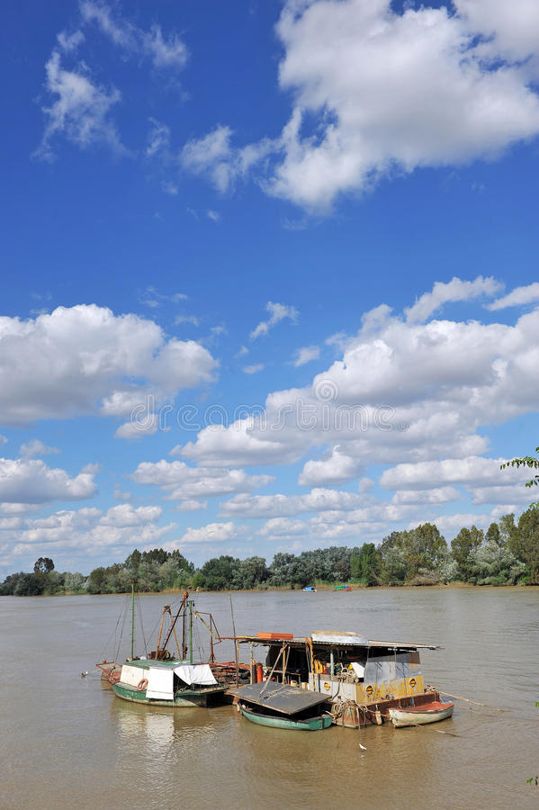Little boats on the Guadalquivir River as it passes through Coria del Rio, Seville province, Andalusia, Spain. Fishing boats and barges on the River Guadalquivir royalty free stock photos