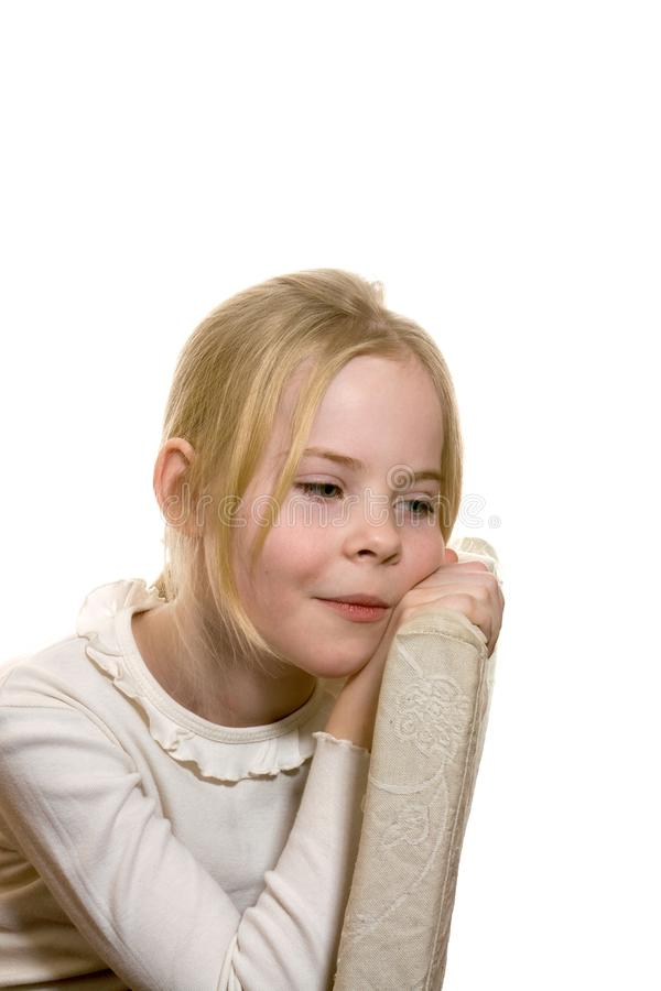 Little bored girl, who sits on chair stock photo