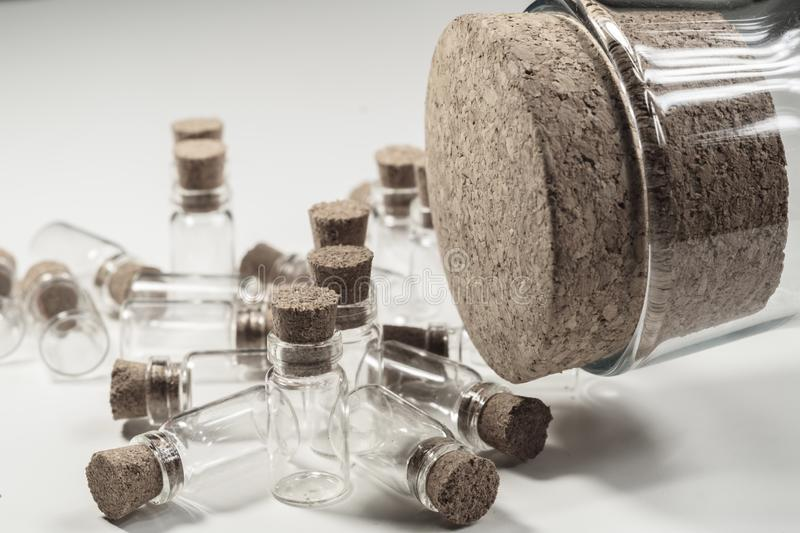 Empty little bottles with cork stopper isolated on white. big bottle with cork. transparent containers. Little bottles with cork stopper isolated on white. big stock photo