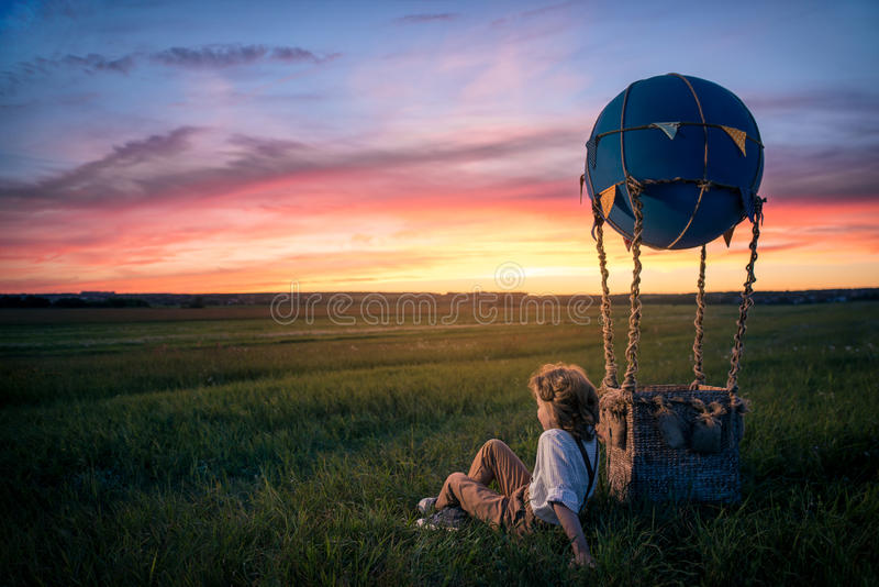Little boy with aerostat. In the field royalty free stock photo
