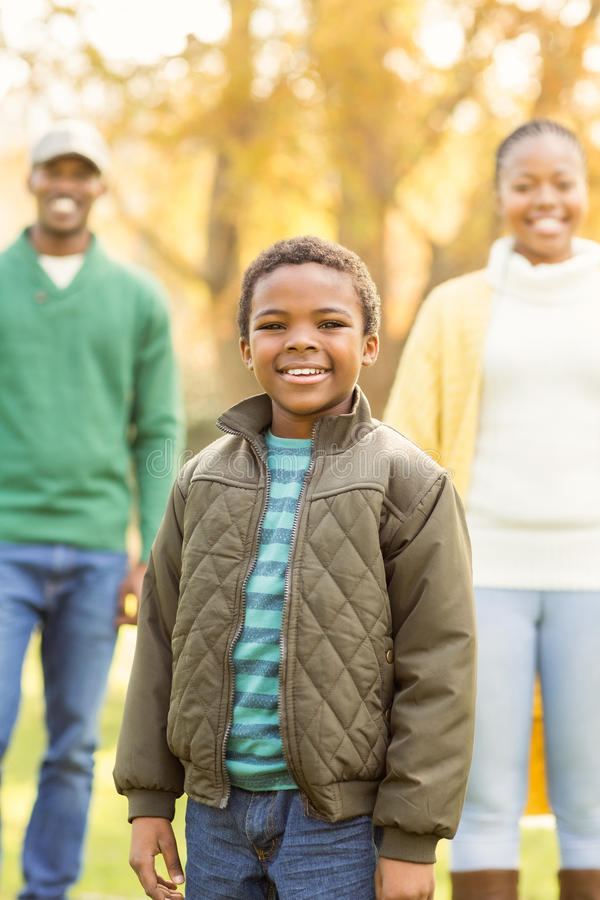 A little boy against his parents in the background stock photo