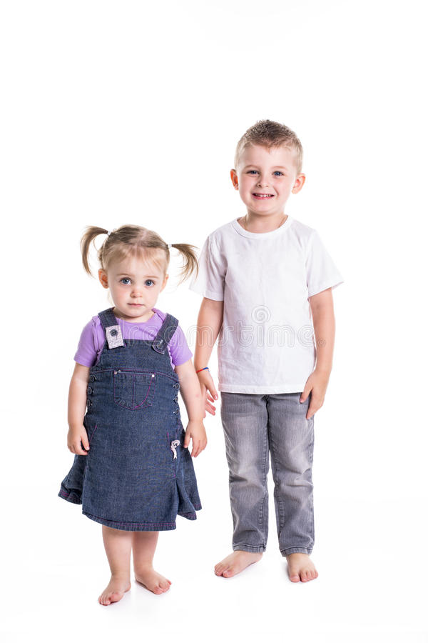 Free Little Boy And Girl Full-lenght Portrait Royalty Free Stock Photo - 99050525