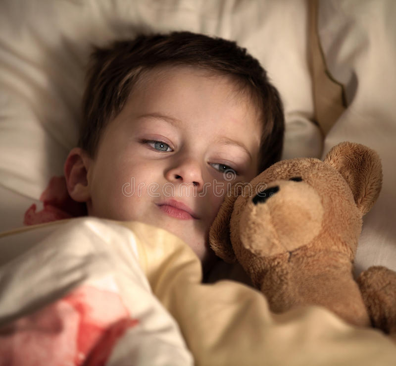 Free Little Boy And His Teddy Bear Are Going To Sleep Royalty Free Stock Image - 29425546