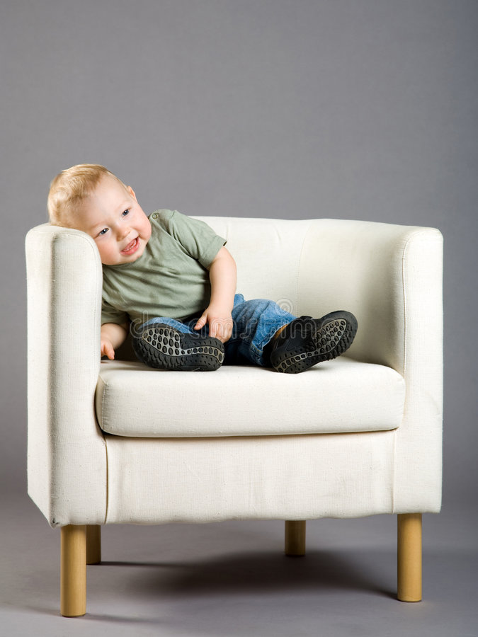 Download Little boy in armchair stock photo. Image of gray, sitting - 7937604
