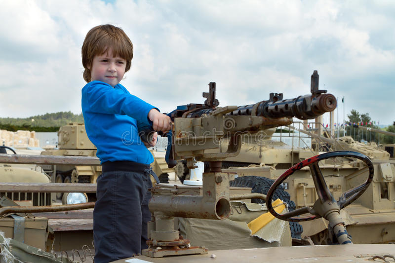 Little boy in a army jeep stock photography