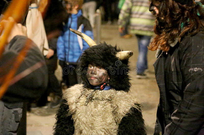 Little boy as Krampus. Brixen/Bressanone, South Tyrol, Italy - December 05, 2013: A traditional parade of the Krampus, beast-like creatures march through the stock images