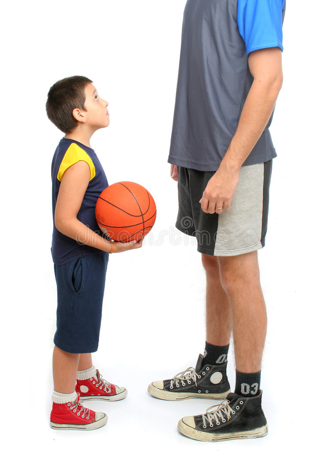 Little boy asking big man to play basketball stock photo