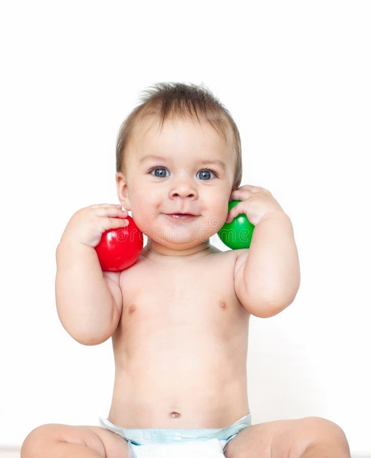 Little boy with a balls stock photos
