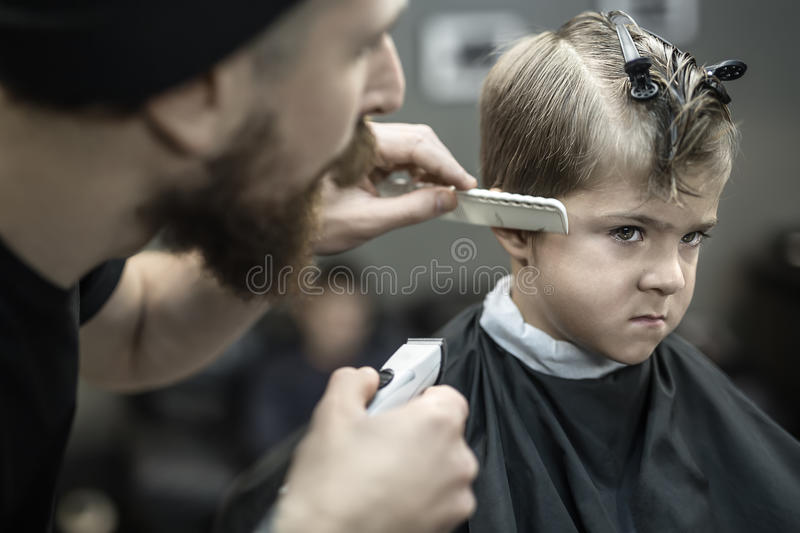 Little boy in barbershop stock images