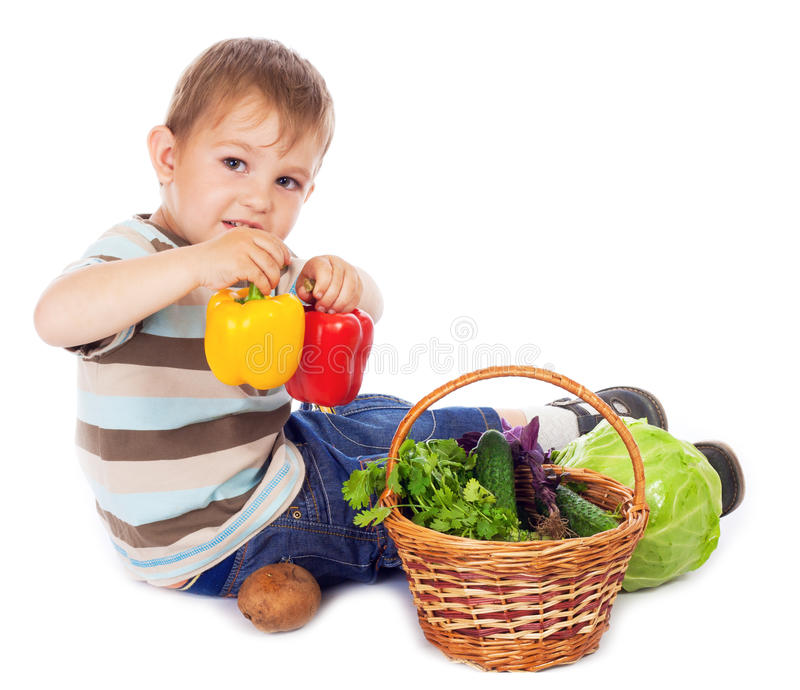 Little boy with basket of vegetables stock photo