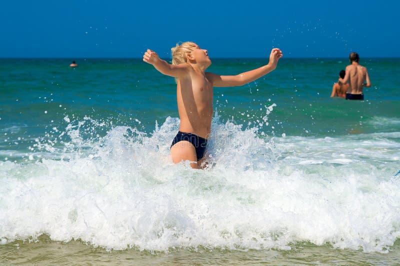 Little boy bathing on the sea royalty free stock photos
