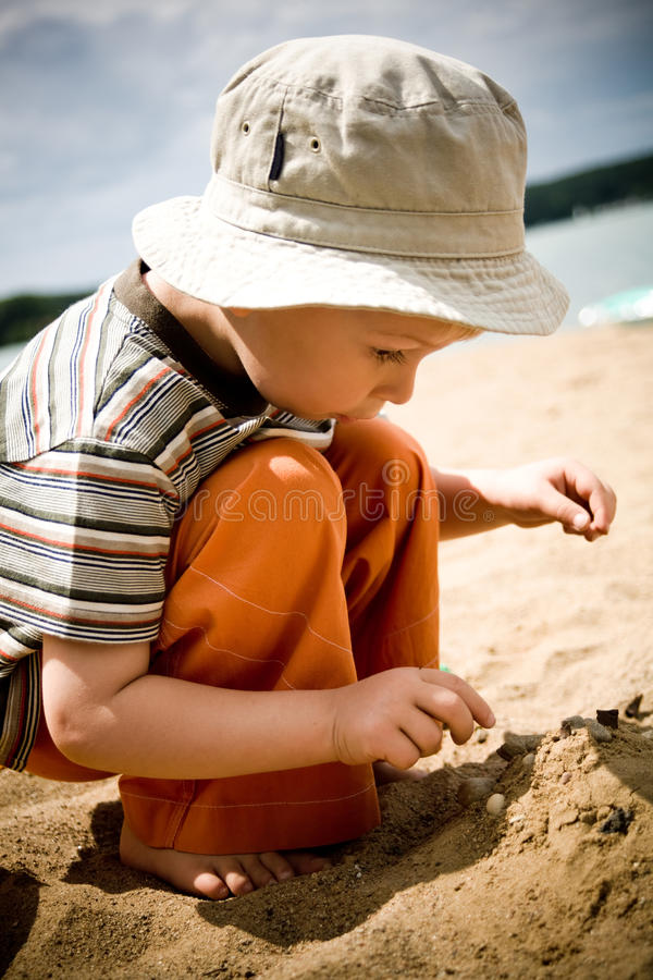 Little boy on beach royalty free stock photos