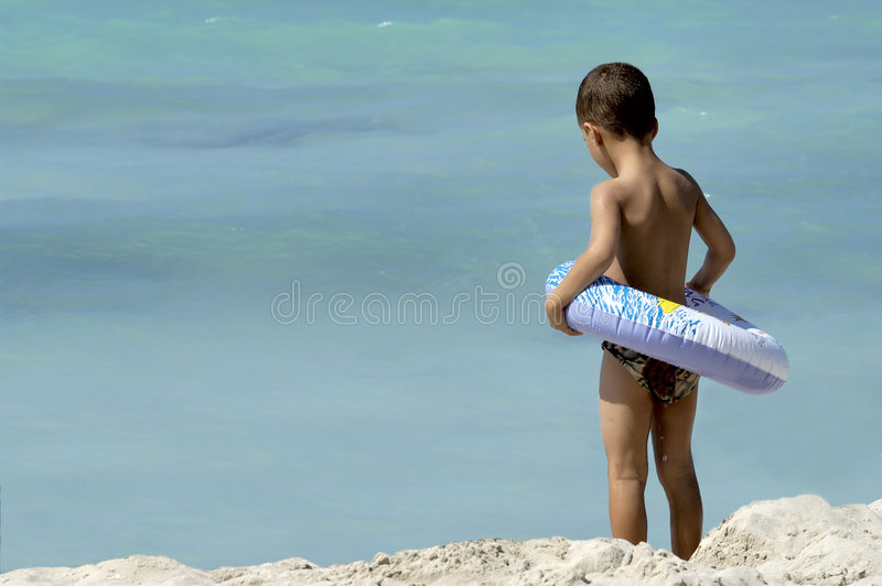Little boy at the beach royalty free stock images