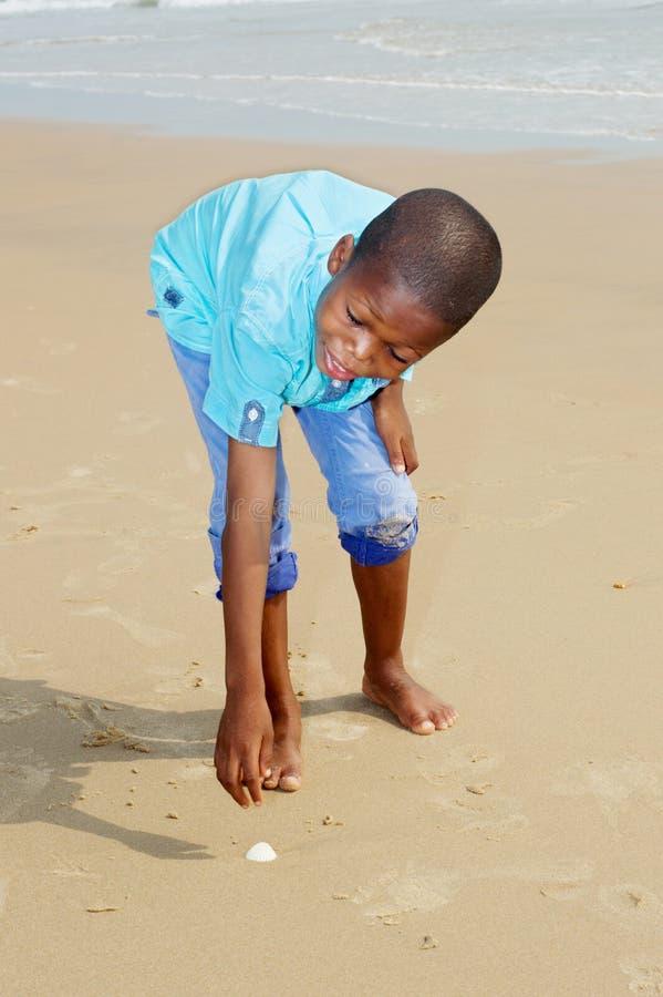 Little boy having fun at the beach stock photo