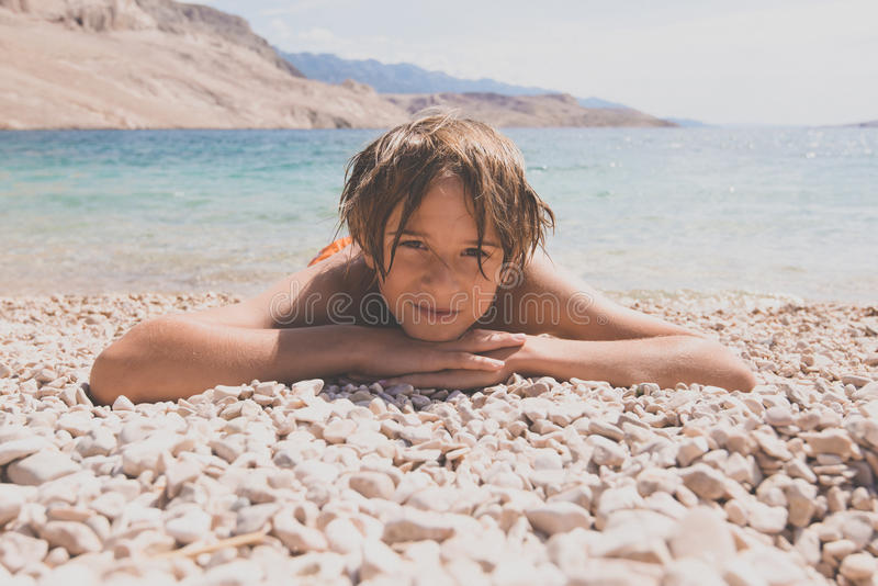 Little boy on the beach royalty free stock photo