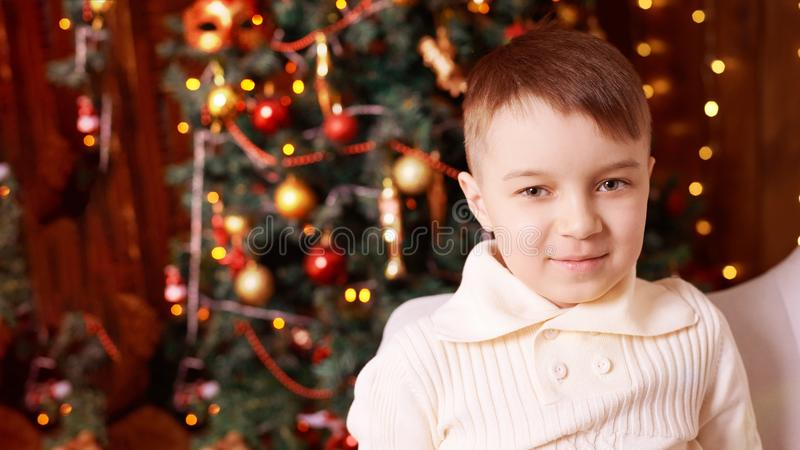 Little boy. Beautiful portrait. Brother. New Year xmas child. Christmas eve holiday. interior stock image