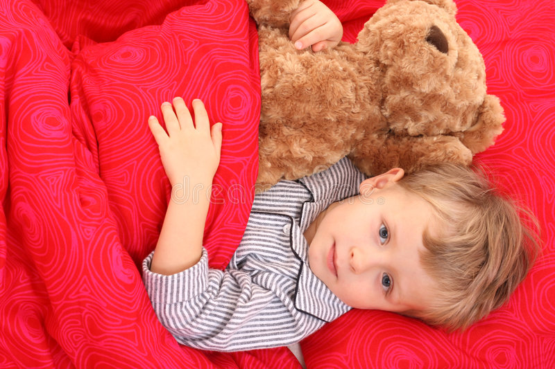 Little boy in bed royalty free stock image