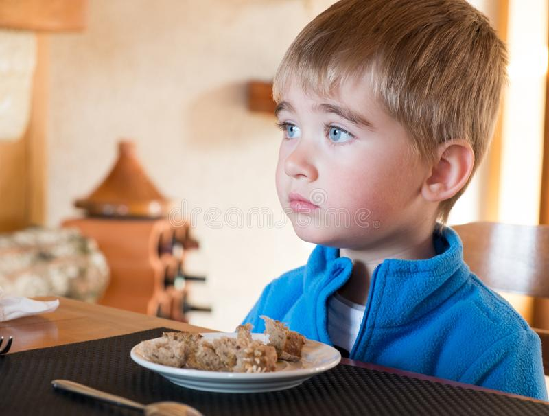 Little Boy Behind Table Royalty Free Stock Photography