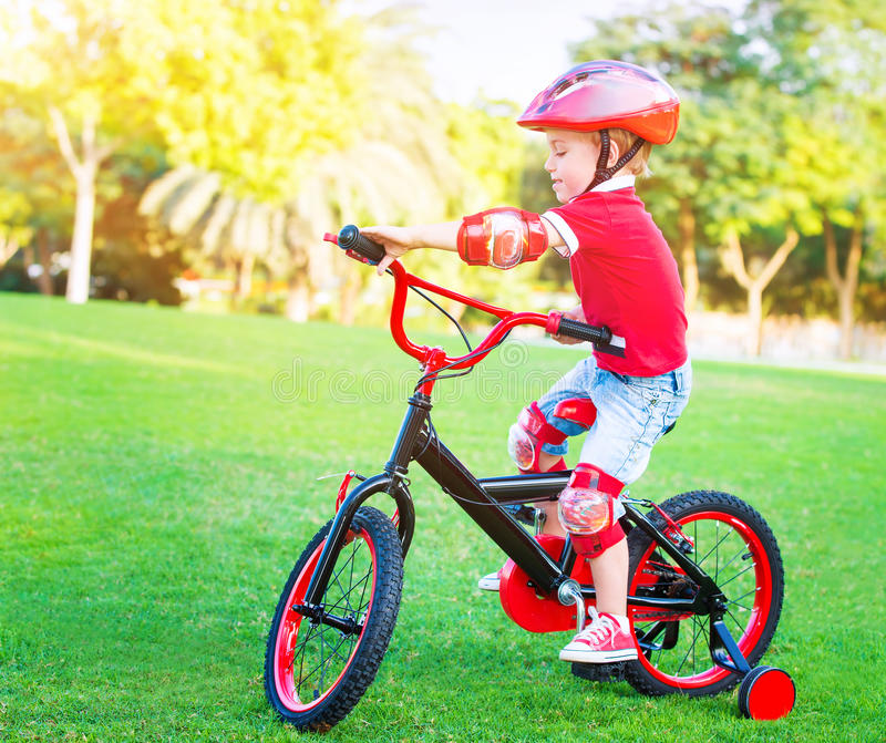Little boy on bicycle royalty free stock photography