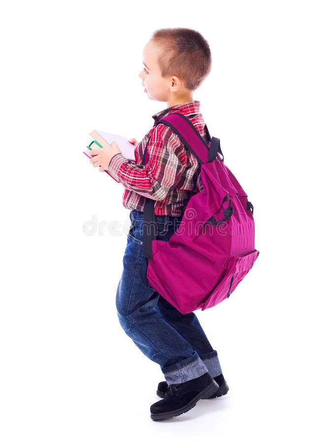 Little boy with big school bag stock images