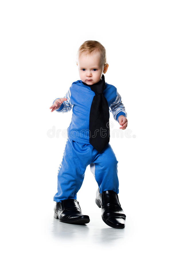 Little boy on the big shoes. Isolated on white royalty free stock images